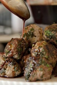 Set these juicy turkey meatballs out on a platter, drizzle with a ginger-spiked sauce of soy, mirin and dark brown sugar and serve with toothpicks alongside win