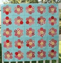 hexagon quilt - SO cute...but the OCD freak in me would put the dark/bright red in the center of all of them for balance...or not have the dark/bright red at all