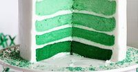 Stunning Green Ombre Layer Cake with Ombre Sprinkles and a great step-by-step tutorial. Anyone can create this jaw-dropping cake!