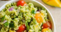 Guacamole Quinoa with Mango - all of the ingredients of guacamole, combined with quinoa and a little mango, for a tasty, healthy side dish! Serve warm or cold.