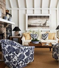 For Living Room - British colonial inspired great room by Anne Hepfer Interiors for CDN House and Home. Nick Brandt photo on wall, Ralph Lauren blue and white fabric chairs ~~~~`
