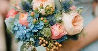 #SomethingBlue: Gorgeous Blue Accents | Globe thistle and hydrangeas are stunning blue accents to the peach flowers in this wedding bouquet. | SouthernLiving.com