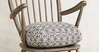 Living room, perhaps to replace blue chair? >> Cushioned Woodwork Chair #anthropologie