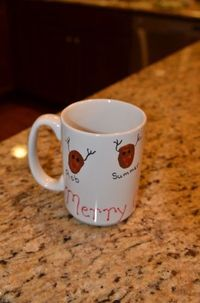 Reindeer Thumbprint Coffee Cup: Coffee cup, $1, Enamel paint, on hand or $1 and up, Sharpie, on hand or $1 for a total of $3.00. Such a great idea for kids to make gifts for the family. You can also let them just simply use permanent markers to write thei...