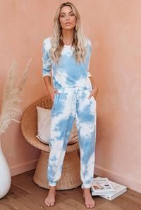 Wear this a jogger set for a fun casual style �€�Swirls of blue and white create a fab tie dye print �€�The knit top has a pullover style, long sleeved �€�Constructed with an elastic waistband with faux ties �€�Side pockets and...