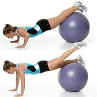 Tones: Shoulders, triceps, chest, and core Lie facedown on a fitness ball, with both hands on the floor. Walk your hands out, allowing the ball to roll beneath