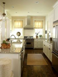 If I can find the same floors that are in the living room to put into the kitchen/dining rooms, it may add just the warm contrast I am looking for! http://bit.ly/HmdDzj