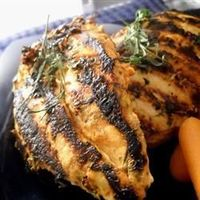 Spicy Tarragon Yogurt Chicken | The sweetness of fresh tarragon tames the spice of homemade harissa sauce in this lively take on chicken breasts.