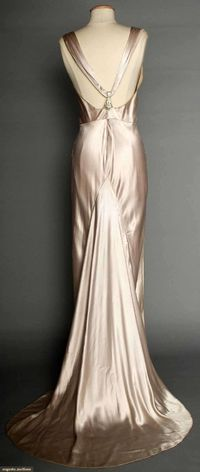 """SILVER SATIN EVENING GOWN, 1930s Pale lavender/silver silk charmeuse, bias-cut, sleeveless, cowl neckline, open back, jeweled Deco elements on shoulder straps & at CB, floating trained back panel, labeled """"NRA Code, Made Under Dress Code Authorit..."""