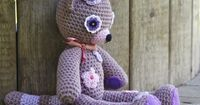Crocheted: Cat with flower crochet eyes is so danged cute! Love this idea.