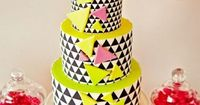 This bright, contemporary wedding cake with a fun graphic design is sure to grab your guests' attention!