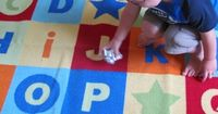 After doing a little foil texture painting, tearing, and gluing - we played a little foil alphabet ball game.
