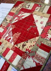Very simple table topper...like the quilting.