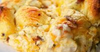 """""""Cracked Out"""" Chicken Bubble Up Recipe - chicken, cheddar bacon, ranch, chicken soup, sour cream and biscuits baked casserole. SO addictive! I literally licked my plate!"""