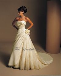 Pretty cream colored strapless wedding gown with side ruching and split skirt