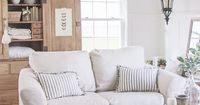 Living Room Slipcovers - A Comfort Works Review | A cozy farmhouse living room with beautiful linen slipcovered sofas.