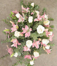 Roses and lilies covered urn. Prove your condolences with this beautiful urn covers. (Color Flower choice).