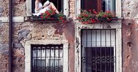 �ƒ��ƒ� Venice, Italy. ~ Could be me. Used to sit on the window seal all the time and read....