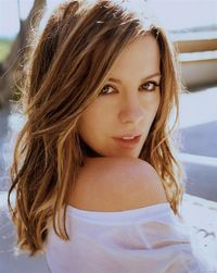 Brown eyes brown hair long hair female woman girl looking over shoulder light white top portrait back lit photograph kate beckinsale celebrity