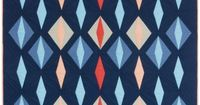 """Designed by Free Range Quilter for Robert Kaufman fabrics. The final quilt measures 55"""" x 66"""" features Essex Cotton-Linen blended fabric."""