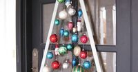Christmas Ornament Door Hanger - Always the Holidays....could get small ornaments from dollar tree for cheap and put a bow on the top! cute idea