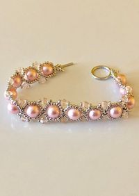 Beaded hand woven pink and silver bracelet $27.00