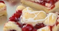 Cherry Pastry Bars 1 cup butter, softened 2 cup sugar 4 eggs 3 cup flour 1/2 tsp almond extract 1 tsp vanilla 1 large can (21 oz.) cherry pie filling Icing 3 tbsp milk , 1 tbsp butter, melted 1 tb...