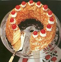 Frankfurter Kranz. Frankfurter Kranz is a cake filled with butter-cream and marmelade, frosted with butter-cream, then decorated with pralines (or almonds) and candied cherries. It is a favorite for coffee-time (in the afternoon) of German...