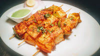 Paneer tikka at home using oven and on Tawa or pan. Cubes of paneer are marinated in Tandoori masala and grilled.