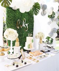 Crying for tropical trees, adorable desserts and lush blooms?! I dare to say, that this Modern Hawaiian Baby Shower at Kara's Party Ideas has it all!