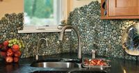 Ceramic, stone, and glass tiles are the go-to materials of choice for most kitchen backsplashes. If you're looking for something a little more unique than your