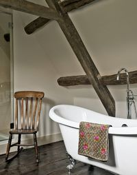Country Bathroom with Polished Floorboards and Freestanding Bath