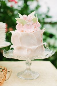 Naturally, we adore a classic white cake, or a sweet confection with gorgeous fresh flowers. But there are some soirees where a more showstopping cake fits the