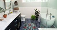 The new tile floor and freestanding tub are just two of the amazing details you'll see in the after version of this bathroom reno. Love it.