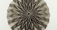 Geometric tessellation along spherical surfaces gives ordinary paper an elegant and modern air. The angle and shape between the folds have been engineered to create the perfect arc. - approx. 25 cm diameter- shipped in a compact, folded arrangement- color