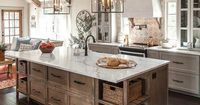 Fixer Upper Farmhouse Kitchen with stained kitchen island with open shelves for wicker baskets and vaulted ceiling with beams.