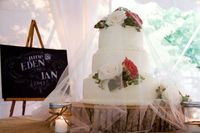 We love this cake veil that is made from a simple piece of tulle draped over a floral wedding cake topper. It adds a romantic touch to the cake and protects it in the event of an outdoor farm wedding crashed by unwanted critters