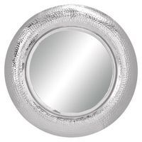 Circular wall mirror with a polished metal frame. Product: Wall mirrorConstruction Material: Metal and mirror...