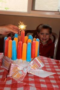 Popcicle Birthday Cake ~ great for a summertime birthday party... stack two pieces of foam and simply stabbed the popcicles in, and covered it with cute birthday ribbon