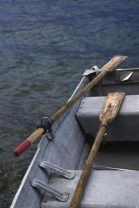 You can hang oars on a wall in two basic ways: visible and invisible. Visible brackets hold an oar like a curtain rod. Cut-down oarlocks make terrific brackets