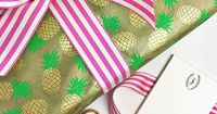 Summer gift wrapped up in our new pineapple handmade paper + striped ribbon in pink #shindigwraps #shindigpaperie