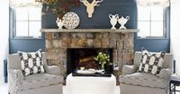nursery inspiration: navy walls, orange accents, and a manly deer �™�