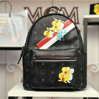MCM Small Stark Essential Floral Backpack In Black