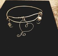 Adjustable wire wrapped heart bangle bracelet with charms $8.50
