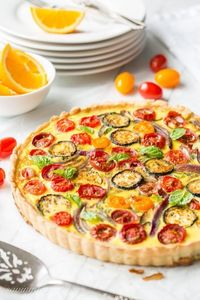 A tasty, fresh vegetable Farmers' Market Quiche filled with zucchini, onions, tomatoes and cheese. A wonderful addition to your brunch table!
