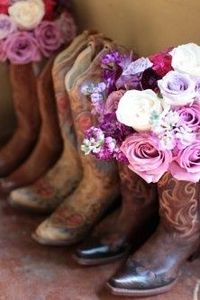 Bridesmaid's bouquets in their boots before wedding for pictures.