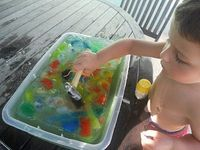 recipe for summer fun for kids: a block of ice with treasure frozen inside.. let it melt or smash away!