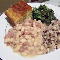 I'm lazy so I modified this as follows: 3 cans of northern beans already cooked, 1.5 packages of already cut carving board ham, also only used about half the brown sugar per reviews. Let simmer just while I made the cornbread since beans were already ...