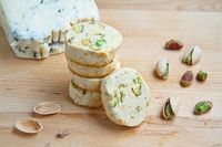 A buttery good savoury shortbread with tangy mellow and tangy gorgonzola, pistachios and a hint of lemon and heat.