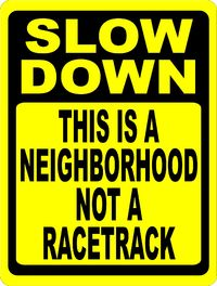 Slow Down This is a Neighborhood Not a Racetrack Sign (Corrugated) with Stake $22.50